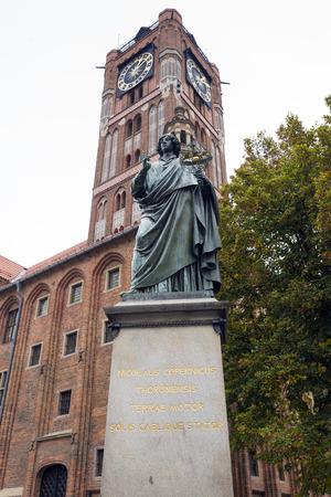 torun: TORUN, POLAND - OCTOBER 23, 2014: Nicolaus Copernicus statue in old town Torun, Poland