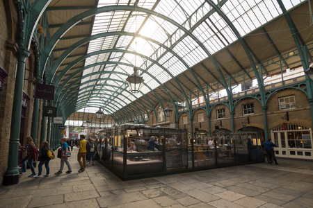 covent garden market: LONDON, UNITED KINGDOM - JUNE 5,  2014: Apple Market, the neo-classical market building is at the heart of Covent Garden, originally a fruit and vegetable market its now a craft market.