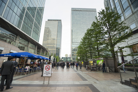 firms: LONDON, UK - JUNE 6, 2014: Friday afternoon in Londons Canary Wharf financial district. The most awaited moment of the week for employees of financial firms