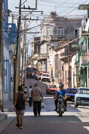 socialism: MATANZAS, CUBA - MAY 10, 2014: People on a busy downtown street in the city of Matanzas, Cuba Editorial