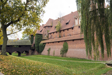 teutonic: Malbork, Poland - October 21, 2014: The Castle of the Teutonic Order in Malbork is the largest castle in the world by surface area. It was built in Prussia by the Teutonic Knights, a German Roman Catholic religious order of crusaders, in a form of an Orde Editorial