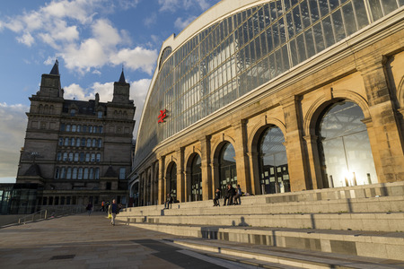 victorian architecture: LIVERPOOL, UNITED KINGDOM - JUNE 8, 2014: Lime Street is Liverpools main rail station and has recently been restored and redeveloped. To the left of the station is the Chateau style Great North Western Hotel, now student accommodation.