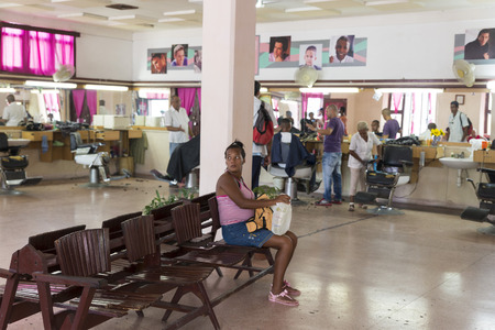 sexes: CIENFUEGOS, CUBA- MAY 7, 2014: Hair Salon for both sexes in Cienfuegos, Cuba