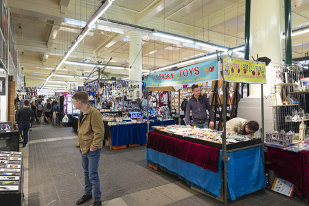 covent: LONDON, UNITED KINGDOM - JUNE 5,  2014: Customers and vendors of souvenirs and knick Jubilee Market, near Covent Garden, London