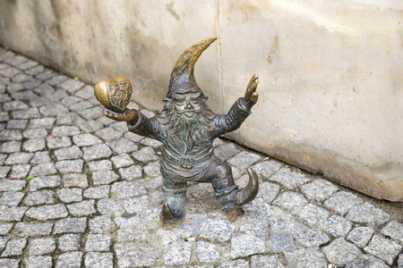 dwarfs: WROCLAW, POLAND - OCTOBER 24, 2014: Wroclaws dwarfs are small figurines that first appeared in the streets of Wrocław in 2001. Since then, their numbers have been continually growing, and today they are considered a tourist attraction