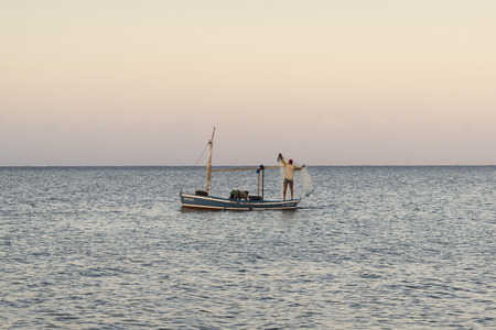 rowboats: TRINIDAD, CUBA - MAY 8, 2014: Two Persons. Cuban Fishermans Net Fishing With Rowboats in Playa Ancon, near Trinidad, Cuba.