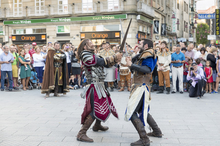jousting: PONTEVEDRA, SPAIN - SEPTEMBER 5, 2014: Historical reenactment of a fight Between medieval knights at the annual festival Feira Franca Editorial