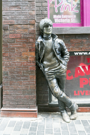 john lennon: LIVERPOOL, UK - JUNE 8, 2014: A statue of John Lennon at Mathew Street situated opposite the historic Cavern Club in Liverpool