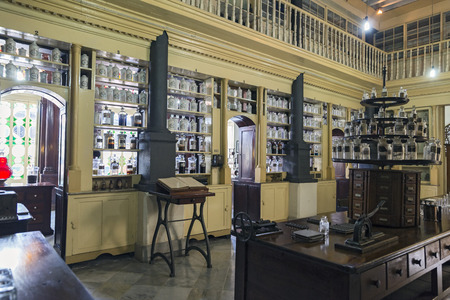 street drug: MATANZAS, CUBA - MAY 10: This old French Colonial pharmacy, formerly known as Botica La Francesa, was founded by Dr Ernesto Triolet in 1882 and stands unchanged today in the city of Matanzas, Cuba. May 10, 2014