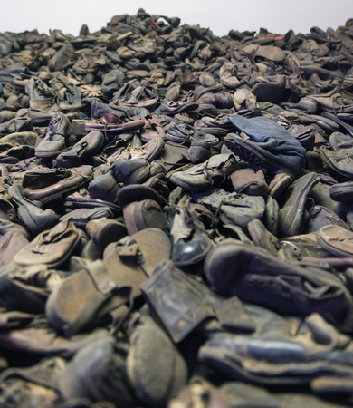 belongings: AUSCHWITZ, POLAND - OCTOBER 25, 2014: Exhibition of the remaining belongings (shoes) of the people killed in Auschwitz, a former Nazi extermination camp