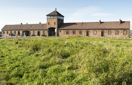 birkenau: AUSCHWITZ, POLAND - OCTOBER 25, 2014: The Main entrance of the infamous Auschwitz II-Birkenau, a former Nazi extermination camp and now a museum