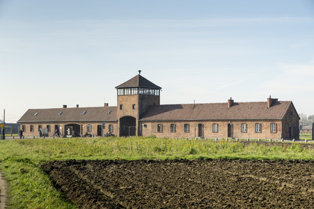 extermination: AUSCHWITZ, POLAND - OCTOBER 25, 2014: The Main entrance of the infamous Auschwitz II-Birkenau, a former Nazi extermination camp and now a museum