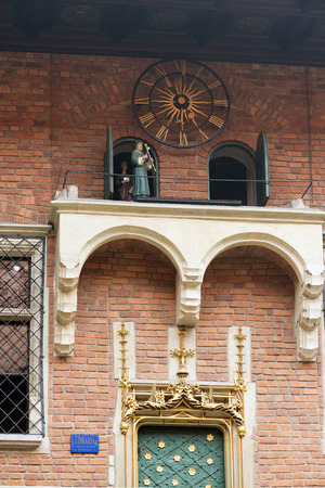 collegium: KRAKOW, POLAND - OCTOBER 26, 2014: Clock in the courtyard of Collegium Maius, the oldest building of the Jagiellonian University. Founded in 1364, its the oldest university in Poland