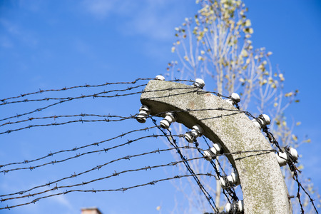 auschwitz memorial: AUSCHWITZ, POLAND - OCTOBER 25, 2014: Barbed wire in the Konzentrationslager Auschwitz was the largest of the German Nazi concentration and extermination camps. Located in southern Poland it took its name from the nearby town of Oswiecim (Auschwitz in Ger