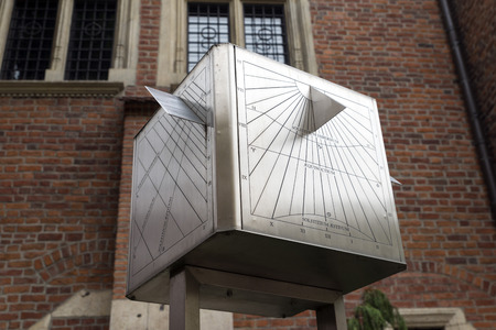 equinox: KRAKOW, POLAND - OCTOBER 26, 2014: A large cube in front of the facade of the university. A sophisticated sundial for the study of variation of the rotation of Earth