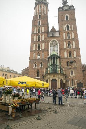 cracovia: KRAKOW, POLAND - OCTOBER 26, 2014: Cracovia Marathon. Runners on the Market Square