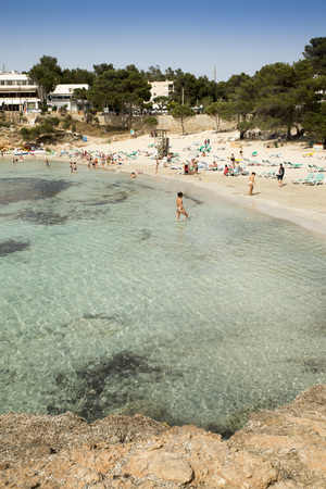 mediterraneo: PORTINATX, IBIZA, SPAIN - MAY 14, 2015: People enjoy the beach on a warm spring afternoon