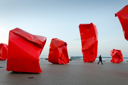 strangers: OSTEND, BELGIUM - OCTOBER 24: Rock Strangers by Arne Quinze. Controversial contemporary work of art on the seabank on October 24, 2013, in Ostend, Belgium
