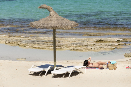 els: FORMENTERA, SPAIN - MAY 12, 2015: People at the beach of  Els Pujols Formentera white sand beach turquoise water in Balearic islands