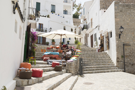 IBIZA, SPAIN - MAY 13, 2015: Ibiza Old Town. A picturesque street of the old town of Ibiza, with its whitewashed houses and bars, restaurants and shops Editorial