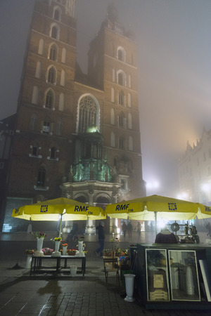 main market: KRAKOW, POLAND - OCTOBER 26, 2014: Main Market Square on a cold foggy night Editorial