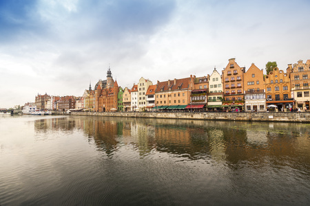 ms: GDANSK, POLAND - OCTOBER 22, 2014: The classic view of Gdansk with the Hanseatic-style buildings reflected in the River Motlawa.