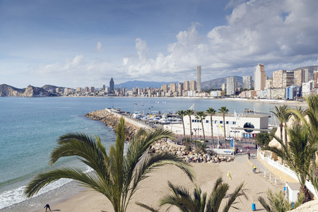 reputed: BENIDORM, SPAIN, JANUARY 18, 2015: A warm autumn day from Benidorms landmark ocean viewpoint. Benidorm is Spains Nr. 1 beach resort, reputed for its sunny climate all year round. Editorial