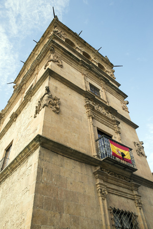 plateresque: SALAMANCA, SPAIN - NOVEMBER 21, 2014: Monterrey Palace. Flag of Spain with black crape in mourning for the death of the Duchess of Alba. The palace is owned by the House of Alba