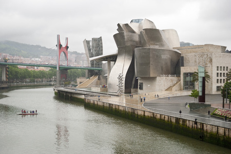 frank   gehry: BILBAO, SPAIN - MAY 14: Exterior view of the Guggenheim Museum on May 14, 2011 in Bilbao, Spain. This Museum is dedicated exhibition of modern art and was designed by Frank Gehry.