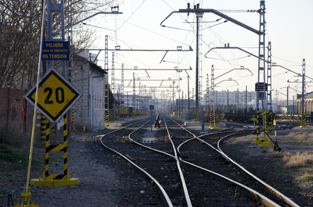 reckless: VALLADOLID, SPAIN - MARCH 14, 2012: An unidentified elderly man crosses railways recklessly by a prohibited area in Valladolid, Spain, on March 14, 2012