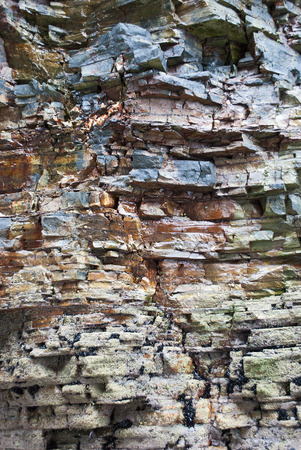 rock strata: Geological strata in a rock near the coast Stock Photo