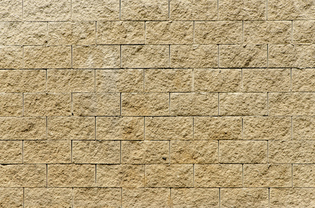 built: Wall built with blocks of ocher color. background