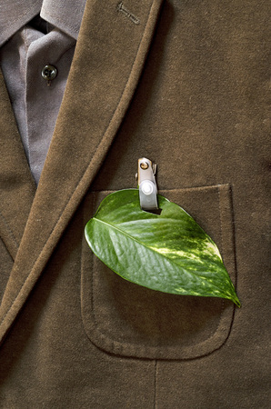 ecologist: Ecologist credited with a green leaf on his jacket