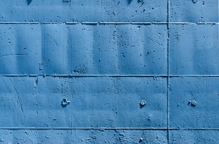 descriptive colors: Blue tinted outer wall, with signs on the surface of the molds that were used in their construction