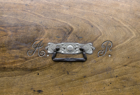 initials: Owners initials engraved on the cover of a chest