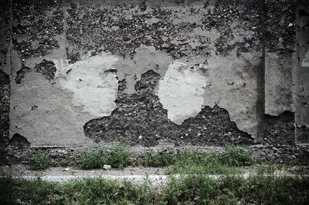 adobe wall: Revoked on adobe wall badly damaged