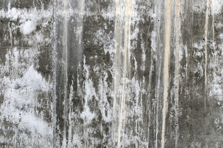trickling: Concrete wall with water trickling down it. Backgrounds Stock Photo
