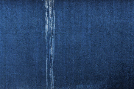trickle: Blue Wall with white trickle. Horizontal.  Background