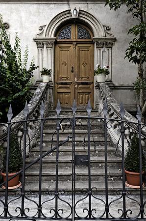 stoop: A old door behind bars Stock Photo