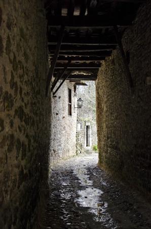 trickle: A dark, damp alley in a village in northern Spain