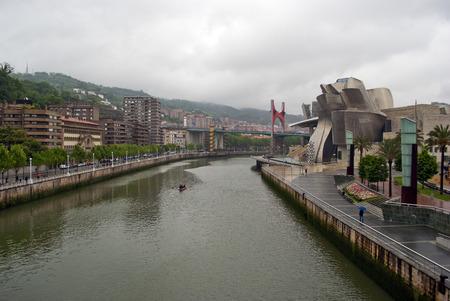 salve: Nervion River as it passes by Bilbao Park, the Guggenheim museum, Univertisy and bridge La Salve, Euskadi, Spain. Basque Country.