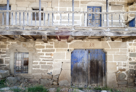 in disrepair: An abandoned rural house, in a serious state of disrepair.