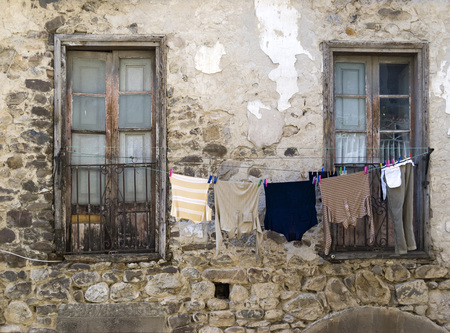 neglect: laundry hanging to dry in a slum house