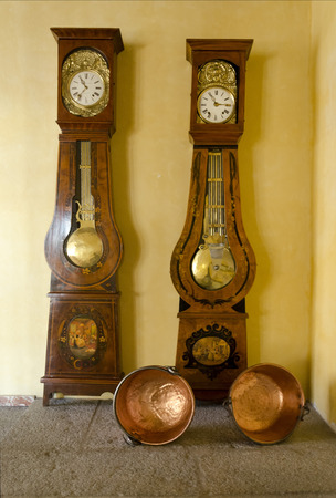 basins: Two grandfather clocks and two copper reeling basins