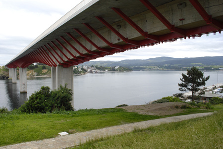 joins: The bridge, over the river Eo, joins the Spanish regions of Galicia and Asturias
