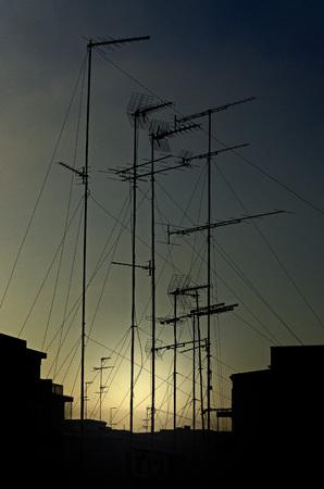 antennas: sky at sunset with many antennas
