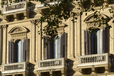 palermo: three windows in a classical style building in Palermo, Sicily