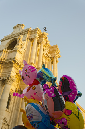 syracuse: colorful balloons against Syracuse Cathedral