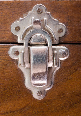 latch: Closeup of a old latch that closes a wooden box