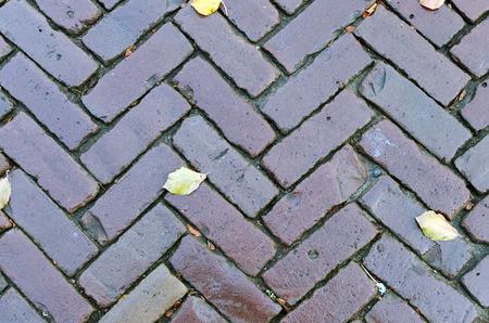 interlocking: Grungy interlocking brick pavement for textured background. Stock Photo